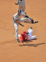 17 June 2012: New York Yankees shortstop Derek Jeter turns a double play getting Ian Desmond out at second and Danny Espinosa out at first during action against the Washington Nationals at Nationals Park in Washington, DC. The Yankees defeated the Nationals 4-1 to sweep their 3-game series. Mandatory Credit: Ed Wolfstein Photo