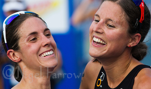 11 SEP 2011 - BEIJING, CHN - Helen Jenkins (GBR) (left) and Melanie Annaheim (SUI) recover after finishing the 2011 Elite Womens ITU World Championship Series Grand Final Triathlon (PHOTO (C) NIGEL FARROW)