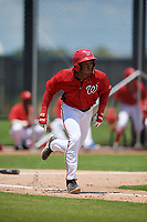 GCL Nationals Jaylen Hubbard (13) runs to first base during a Gulf Coast League game against the GCL Astros on August 9, 2019 at FITTEAM Ballpark of the Palm Beaches training complex in Palm Beach, Florida.  GCL Nationals defeated the GCL Astros 8-2.  (Mike Janes/Four Seam Images)