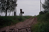 Evda Nignaya, Russia<br /> July, 1998<br /> <br /> A woman heads to her private field of potatoes in a small village.