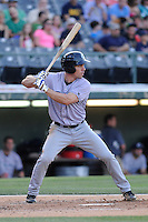 Right fielder Matt Carson (25) of the Columbus Clippers bats in a game against the Charlotte Knights on Saturday, June 15, 2013, at Knights Stadium in Fort Mill, South Carolina. Columbus won, 4-2. (Tom Priddy/Four Seam Images)