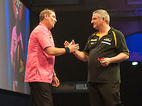 21.12.2014.  London, England.  William Hill World Darts Championship.  Dean Winstanley (26) [ENG] and Wayne Jones [ENG] shake hands after their match. Winstanley own the match 3-2