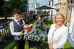 Catriona White  Les Brzozka Duty Manager seated and Dara Looney getting the International Hotel ready for the return of outside dining