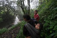 November 20, 2014.<br /> Una mujer maya camina junto al río Cambalan donde la empresa española Ecoener quiere construir una hidroeléctrica, en Santa Cruz de Barillas (Guatemala).<br />   La llegada de algunas compañías extranjeras a América Latina ha provocado abusos a los derechos de las poblaciones indígenas y represión a su defensa del medio ambiente. En Santa Cruz de Barillas, Guatemala, el proyecto de la hidroeléctrica española Ecoener ha desatado crímenes, violentos disturbios, la declaración del estado de sitio por parte del ejército y la encarcelación de una decena de activistas contrarios a los planes de la empresa. Un grupo de indígenas mayas, en su mayoría mujeres, mantiene cortado un camino y ha instalado un campamento de resistencia para que las máquinas de la empresa no puedan entrar a trabajar. La persecución ha provocado además que algunos ecologistas, con órdenes de busca y captura, hayan tenido que esconderse durante meses en la selva guatemalteca.<br /> <br /> En Cobán, también en Guatemala, la hidroeléctrica Renace se ha instalado con amenazas a la población y falsas promesas de desarrollo para la zona. Como en Santa Cruz de Barillas, el proyecto ha dividido y provocado enfrentamientos entre la población. La empresa ha cortado el acceso al río para miles de personas y no ha respetado la estrecha relación de los indígenas mayas con la naturaleza. © Calamar2/Pedro ARMESTRE<br /> <br /> The arrival of some foreign companies to Latin America has provoked abuses of the rights of indigenous peoples and repression of their defense of the environment. In Santa Cruz de Barillas, Guatemala, the project of the Spanish hydroelectric Ecoener has caused murders, violent riots, the declaration of a state of siege by the army and the imprisonment of a dozen activists opposed to the project . <br /> A group of Mayan Indians, mostly women, has cut a path and has installed a resistance camp to prevent the enter of the company's machines. The prosecution has also pr