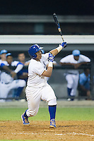 Xavier Fernandez (4) of the Burlington Royals follows through on his swing against the Princeton Rays at Burlington Athletic Park on July 9, 2014 in Burlington, North Carolina.  The Rays defeated the Royals 3-0.  (Brian Westerholt/Four Seam Images)