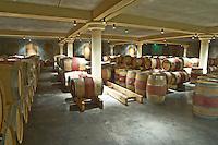 Oak barrel aging and fermentation cellar. Chateau Bellefont Belcier, Saint Emilion, bordeaux, France
