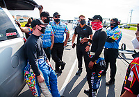 Aug 9, 2020; Clermont, Indiana, USA; NHRA top fuel driver Justin Ashley (left) talks with Antron Brown during the Indy Nationals at Lucas Oil Raceway. Mandatory Credit: Mark J. Rebilas-USA TODAY Sports
