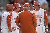 Texas Longhorns Jordan Etier #7, Jacob Felts #12 and Alex Silver #11 meet with head coach Auggie Garrido during the ninth inning of NCAA baseball game against the Texas A&M Aggies on April 29, 2012 at UFCU Disch-Falk Field in Austin, Texas. The Longhorns beat the Aggies 2-1 in the last ever regular season game scheduled for the long time rivals. (Andrew Woolley / Four Seam Images)