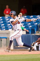 Christian Bethancourt #19 of the Rome Braves follows through on his swing against the Greenville Drive at State Mutual Stadium July 25, 2010, in Rome, Georgia.  Photo by Brian Westerholt / Four Seam Images