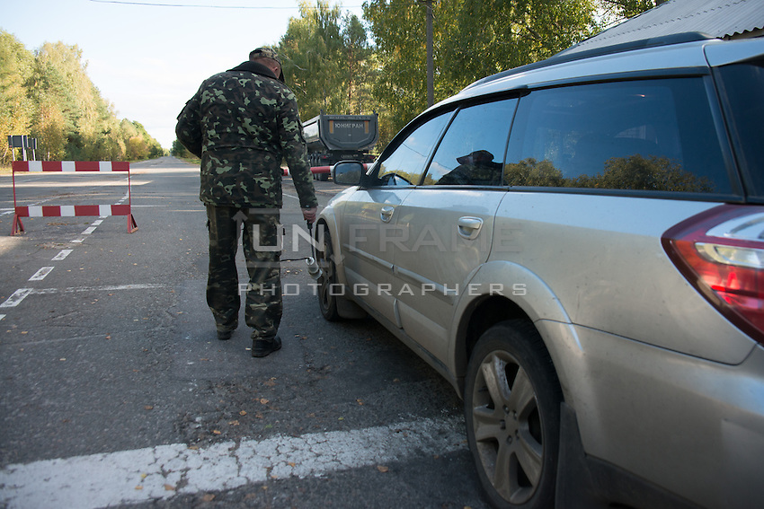 Mandatory documents check and radiation control for all vehicles entering and leaving 30km exclusion zone around Chernobyl Nuclear Power Plant.