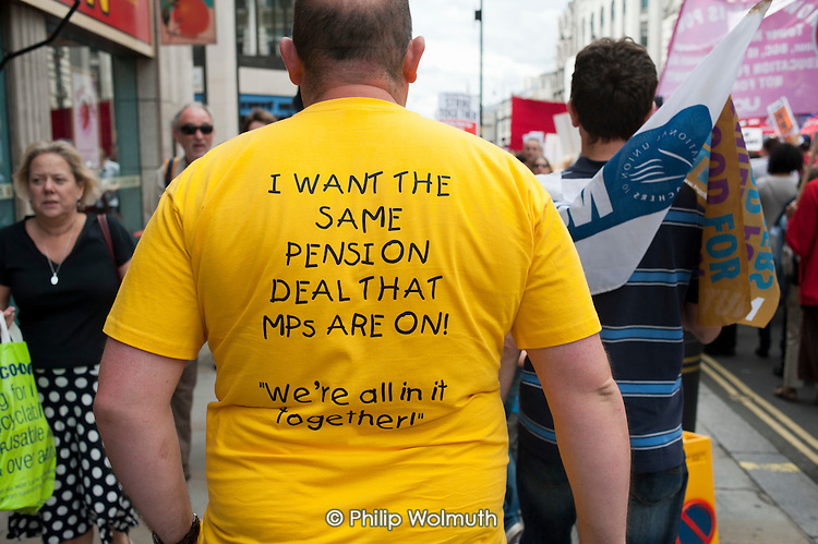 """We're all in it together"". Striking public sector workers demonstrate in London over planned pension changes."