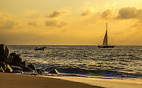 Fine Art Landscape Photograph, of the skyline along Banderas Bay in Puerto Vallarta, Mexico.<br /> A golden sunset casting a romantic lighting upon a sailboat as it sails into the sunset.