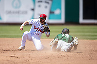 Lansing Lugnuts shortstop Max Schuemann (8) tags out a baserunner at second base on May 30, 2021 against the Great Lakes Loons at Jackson Field in Lansing, Michigan. (Andrew Woolley/Four Seam Images)