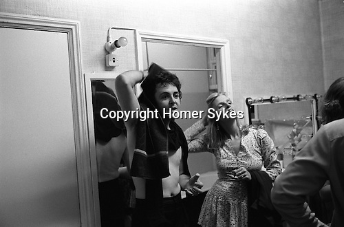 "Paul and Linda McCartney Wings Tour 1975. Paul and Linda in their dressing room after their performance Bristol, England.. The photographs from this set were taken in 1975. I was on tour with them for a children's ""Fact Book"". This book was called, The Facts about a Pop Group Featuring Wings. Introduced by Paul McCartney, published by G.Whizzard. They had recently recorded albums, Wildlife, Red Rose Speedway, Band on the Run and Venus and Mars. I believe it was the English leg of Wings Over the World tour. But as I recall they were promoting,  Band on the Run and Venus and Mars in particular."