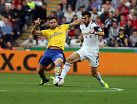 Saturday 28 September 2013<br /> Pictured L-R: Olivier Giroud of Arsenal tackling Jordi Amat of Swansea. <br /> Re: Barclay's Premier League, Swansea City FC v Arsenal at the Liberty Stadium, south Wales.
