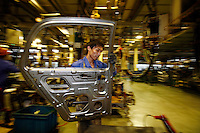 Workers at the Geely automobile factory work on the assembly line at the company's site in Ningbo, China. Along with other auto makers in China, Geely is now looking overseas to sell its vehicles as stock increases and domestic margine declines. China is currently the world's 4th largest auto maker, plans to boost vehicle and automobile components exports by 15 folds to more than 120 billion yuan (15 billion US) in the next 10 years..