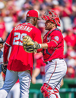 22 June 2014: Washington Nationals catcher Sandy Leon congratulates closing pitcher Rafael Soriano on a win against the Atlanta Braves at Nationals Park in Washington, DC. The Nationals defeated the Braves 4-1 to split their 4-game series and take sole possession of first place in the NL East. Mandatory Credit: Ed Wolfstein Photo *** RAW (NEF) Image File Available ***