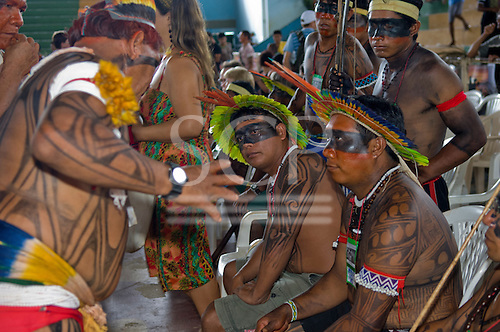 """Altamira, Brazil. """"Xingu Vivo Para Sempre"""" protest meeting about the proposed Belo Monte hydroeletric dam and other dams on the Xingu river and its tributaries. Yudja, Kaiabi and Kuikuro leaders confer."""