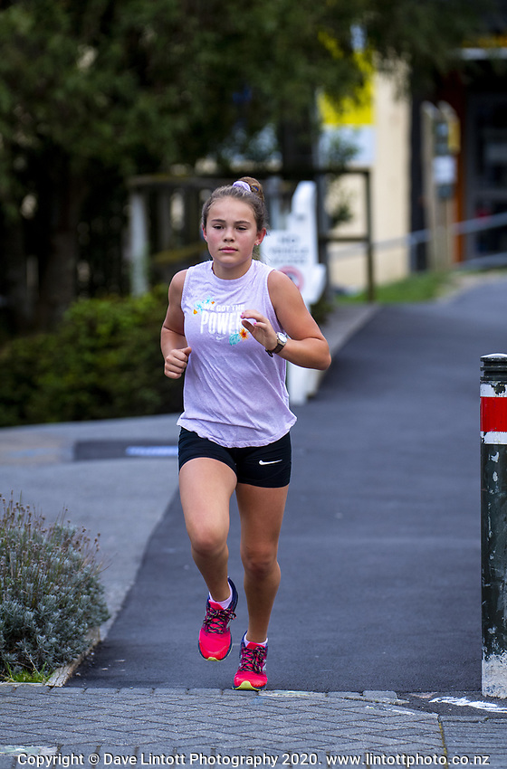 A runner in Ngaio at 4.15pm, Wednesday, during lockdown for the COVID19 pandemic in Wellington, New Zealand on Wednesday, 22 April 2020. Photo: Dave Lintott / lintottphoto.co.nz