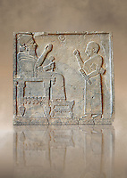 "Relief panels orthostat from northern part of the hall at the Palace of Sam 'al - Zincirli. On the throne sits the Prince Barrakib, before him stands a scribe with his pen with a writing board under his arm. Above their heads each side of a crescent moon  are inscriptions in Aramaic ""I am Barrakib, son of Panammuwa"" and the inscription ""My Lord of the Ba 'al of Harran"" with symbols of the moon god.Neo Syro Hittite.  Basalt around 730 BC. Neo Syro Hittite.  Basalt around 730 BC.  Pergamon Museum, Berlin, inv no VA2817"