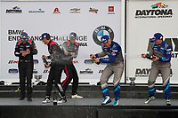 #57 Winward Racing Mercedes-AMG GT GT4, GS: Bryce Ward, Philip Ellis, #35 Riley Motorsports Mercedes-AMG GT GT4, GS: James Cox, Dylan Murry, Jeroen Bleekemolen, #4 Winward Racing Mercedes-AMG GT GT4, GS: Russell Ward, Indy Dontje, podium, champagne