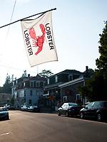 USA, Neuengland, Hauptstrasse in Stonington, 02.09.2010<br /> <br /> Engl.: USA, New England, Stonington, main road, flag, 02 September 2010