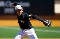 Starting pitcher Charlie Cononie #35 of the Towson Tigers in action against the Minnesota Golden Gophers at Gene Hooks Field on February 26, 2011 in Winston-Salem, North Carolina.  The Gophers defeated the Tigers 6-4.  Photo by Brian Westerholt / Sports On Film