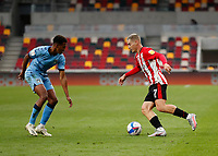 17th October 2020; Brentford Community Stadium, London, England; English Football League Championship Football, Brentford FC versus Coventry City; Sergi Canos of Brentford being marked by Sam McCallum of Coventry City