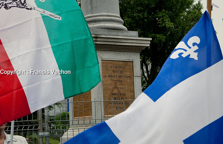 """A Quebec and a """"patriot"""" flag fly in front of Wolfe's monument on the Plains of Abraham in Quebec city July 1, 2009. The RRQ held their annual protest against Canada by collecting Canada flags to """"send them back to the sender"""".<br /> <br /> PHOTO :  Francis Vachon - Agence Quebec Presse"""