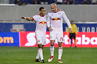 Harrison, NJ - Thursday March 01, 2018: Tyler Adams, Aurélien Collin. The New York Red Bulls defeated C.D. Olimpia 2-0 (3-1 on aggregate) during a 2018 CONCACAF Champions League Round of 16 match at Red Bull Arena.