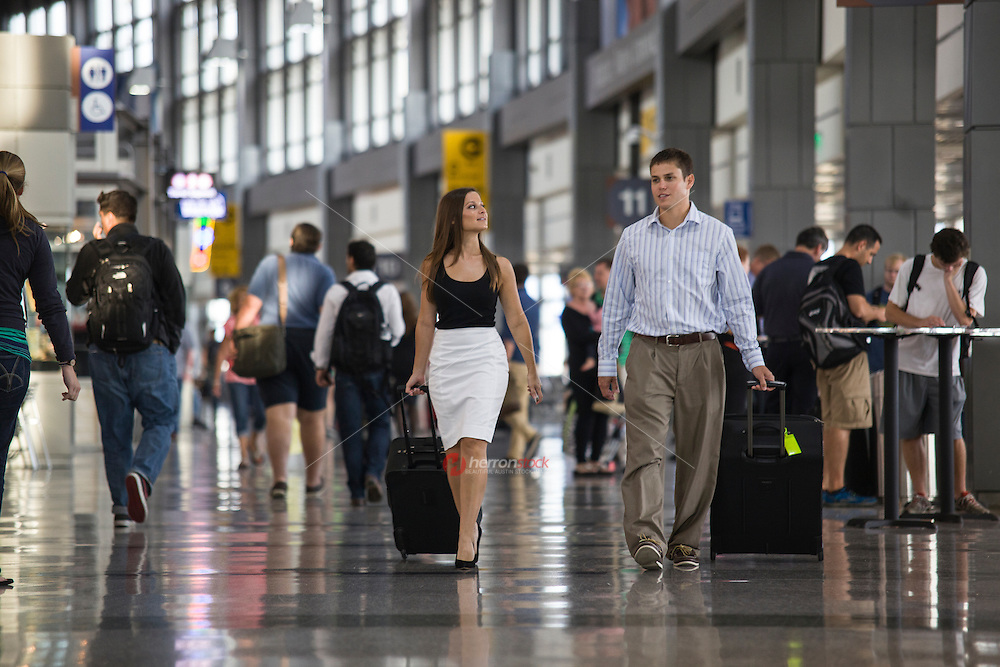 View of attractive couple walking to departure gate at Austin airport terminal in Austin, Texas.