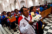 """Natives from the Kamentsá tribe participate in the Catholic mass during the Carnival of Forgiveness, a traditional indigenous celebration in Sibundoy, Colombia, 12 February 2013. Clestrinye (""""Carnaval del Perdón"""") is a ritual ceremony kept for centuries in the Valley of Sibundoy in Putumayo (the Amazonian department of Colombia), a home to two closely allied indigenous groups, the Inga and Kamentsá. Although the festival has indigenous origins, the Catholic religion elements have been introduced and merged with the shamanistic tradition. Celebrating annually the collaboration, peace and unity between tribes, they believe that anyone who offended anyone may ask for forgiveness this day and all of them should grant pardons."""