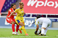 CALI – COLOMBIA, 20-11-2020: Jugadoras del América y Pasto en acción durante partido por la Fecha 6 de la Liga Femenina BetPlay DIMAYOR 2020 entre América de Cali y Deportivo Pasto jugado en el estadio Pascual Guerrero de la ciudad de Cali. / Players of America and Pasto in action during match for the date 6 as part of Women's BetPlay DIMAYOR League 2020 between America de Cali and Deportivo Pasto played at Pascual Guerrero stadium in Cali city. Photos: VizzorImage / Nelson Rios / Cont /.