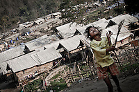 A Kachin refugee child plays in a hill among tents settled to give shelter to the displaced persons in one of the largest IDP camps close to Laiza KIA stronghold city. Five thousand IDP's have been settled in this camp since the ceasefire was broken out by the Burmese army last June 2011. During months the fighting were spread out along the Kachin State leaving more than 40,000 displaced persons and refugees (a conservative estimating) in accord with the humanitarian aid groups.