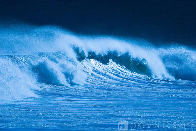Breaking surf details, blue saturation, motion blur, Mill Bay beach, Kodiak Alaska, USA.