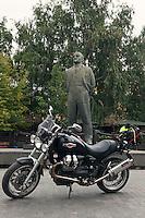 Moscow, Russia, 12/08/2013.<br /> Moto Guzzi Bellagio statue of Lenin behind.
