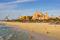 Jumeirah Beach, the Mina a?Salam Hotel,  part of the Madiant Jumeirah, and Jumeirah Beach Hotel. Dubai. United Arab Emirates.