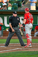 Home plate umpire Jake Botek and Brennan Morgan (23) of the Orem Owlz discuss the call at home plate during the game against the Ogden Raptors in Pioneer League action at Lindquist Field on July 29, 2016 in Ogden, Utah. Orem defeated Ogden 8-5. (Stephen Smith/Four Seam Images)