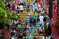 Tourists relax on Selaron's Stairs (Escadaria Selarón), a colorful mosaic tile stairway, in Rio de Janeiro, Brazil, 21 February 2012. World-famous staircase, mostly covered by vibrant yellow, green and blue tiles (inspired by the colors of the Brazilian flag), is the masterpiece of Chilean-born artist Jorge Selarón who considers it as a personal tribute to the Brazilian people. Connecting the neighborhoods of Santa Teresa and Lapa, the stairway is made up of 250 steps and measures 125 meters long. In 1990 Selarón began work on the stairway, creating a constantly evolving piece of art, now adorned with over 2,000 brightly colored tiles collected from over 60 countries. Selarón funds his one man's project through donations and the sale of his black-and-red paintings which mostly depict a pregnant African woman or himself. Living his passion, the eccentric 65-year-old artist claims that this crazy and unique dream will only end on the day of my death.