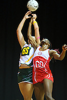 South Africa's Chrisna Bootha, left, and England's Ama Abgeze compete for the ball in the New World Quad series netball match, Claudelands Arena, Hamilton, New Zealand, Thursday, November 01, 2012. Credit:NINZ / Dianne Manson.