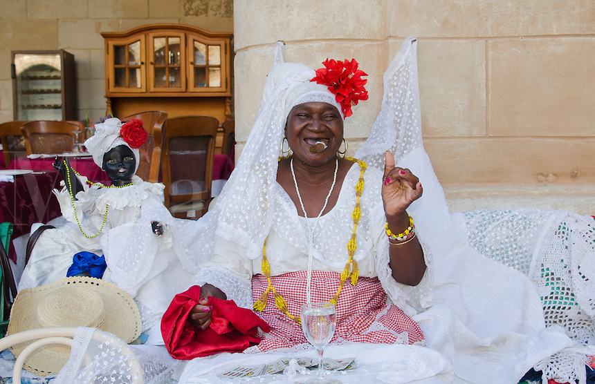 Havana Cuba Santeria woman local with Tarot cards and cigar for future readings