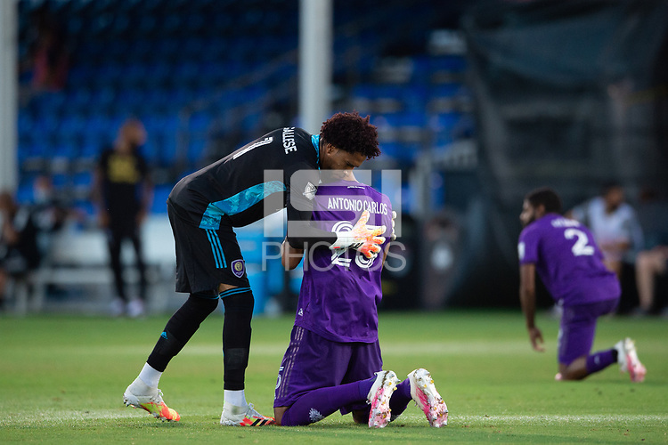 LAKE BUENA VISTA, FL - JULY 25: Pedro Gallese #1 and Antonio Carlos #25 of Orlando City SC before the game during a game between Montreal Impact and Orlando City SC at ESPN Wide World of Sports on July 25, 2020 in Lake Buena Vista, Florida.