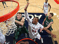 CHARLOTTESVILLE, VA- NOVEMBER 26:  Akil Mitchell #25 of the Virginia Cavaliers defends Daniel Turner #22 of the Green Bay Phoenix during the game on November 26, 2011 at the John Paul Jones Arena in Charlottesville, Virginia. Virginia defeated Green Bay 68-42. (Photo by Andrew Shurtleff/Getty Images) *** Local Caption *** Daniel Turner;Akil Mitchell