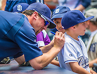 23 June 2013: San Diego Padres pitcher Luke Gregerson autographs the back of a young fans jersey prior to a game against the Los Angeles Dodgers at Petco Park in San Diego, California. The Dodgers defeated the Padres 3-1, splitting their 4-game Divisional Series at 2-2. Mandatory Credit: Ed Wolfstein Photo *** RAW (NEF) Image File Available ***