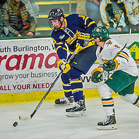 21 February 2015:  Merrimack College Warrior Defenseman Aaron Titcomb, a Freshman from Charlestown, MA, in first period action against the University of Vermont Catamounts at Gutterson Fieldhouse in Burlington, Vermont. The teams played to a scoreless tie as the Cats wrapped up their Hockey East regular home season. Mandatory Credit: Ed Wolfstein Photo *** RAW (NEF) Image File Available ***