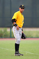 GCL Pirates infielder Francisco Aponte #24 warms up before a game against the GCL Braves at Disney Wide World of Sports on June 25, 2011 in Kissimmee, Florida.  The Pirates defeated the Braves 5-4 in ten innings.  (Mike Janes/Four Seam Images)