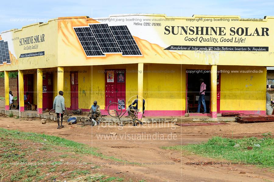 UGANDA, Karamoja, Kotido, Karamojong pastoral tribe, shop selling solar panels for power generation and bicycle repair
