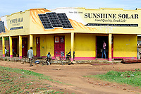 UGANDA, Karamoja, Kotido, Karamojong pastoral tribe, shop selling solar panels for power generation and bicycle repair