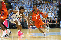 CHAPEL HILL, NC - JANUARY 11: Al-Amir Dawes #2 of Clemson University drives past Leaky Black #1 of the University of North Carolina during a game between Clemson and North Carolina at Dean E. Smith Center on January 11, 2020 in Chapel Hill, North Carolina.