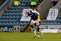 20th February 2021; Dens Park, Dundee, Scotland; Scottish Championship Football, Dundee FC versus Queen of the South; Liam Fontaine of Dundee heads clear from Niyah Joseph of Queen of the South